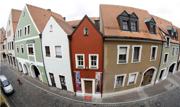 An 8-foot 'skinny home' in Germany is the world's smallest hotel, with a max occupancy of 2. Take a look inside.